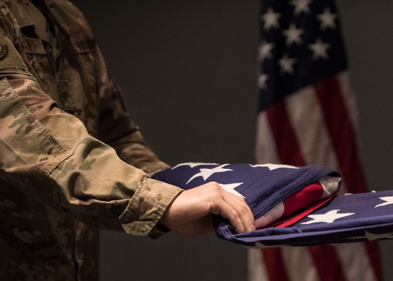 U.S. Air Force Staff Sgt. Joseph Fabiano, 435th Construction and Training Squadron engineering contingency instructor, performs a flag folding ceremony for Retired Maj. Ralph L. Turner, Tuskegee Airman, at Ramstein Air Base, Germany, April 24, 2020.
