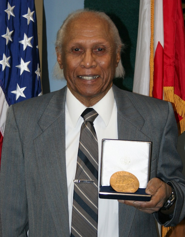 Retired U.S. Air Force Maj. Ralph L. Turner, a Tuskegee Airman, stands with his Congressional Gold Medal Feb. 19, 2008.