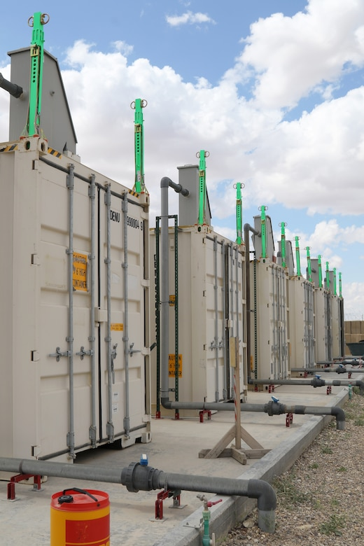 Metal containers function as bioreactors at a new wastewater treatment plant that started operation at Al Asad Air Base, Iraq, in April. The facility, which cost about $4 million to build, is expected to save money, increase security and help the area's environment. Coalition Forces remain united and determined in its mission to degrade and defeat Daesh and continues to work with allies and partners to implement stabilization efforts. (U.S. Army by Sgt. 1st Class Gary A. Witte)