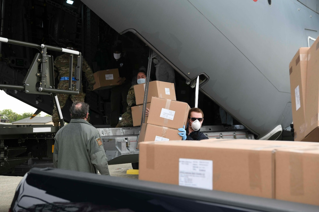 Turkish and U.S. Air Force crew members unload medical supplies from a Turkish Airbus A400M Atlas.