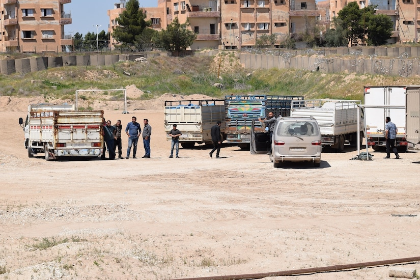 Empty trucks that held basic hygiene and medical supplies for detention facilities across northeast Syria prepare to move out at Ash Shaddaddi, Syria the week of April 13, 2020. These supplies are part of a handoff from the Coalition to further support the region's readiness to prevent the spread of COVID-19.