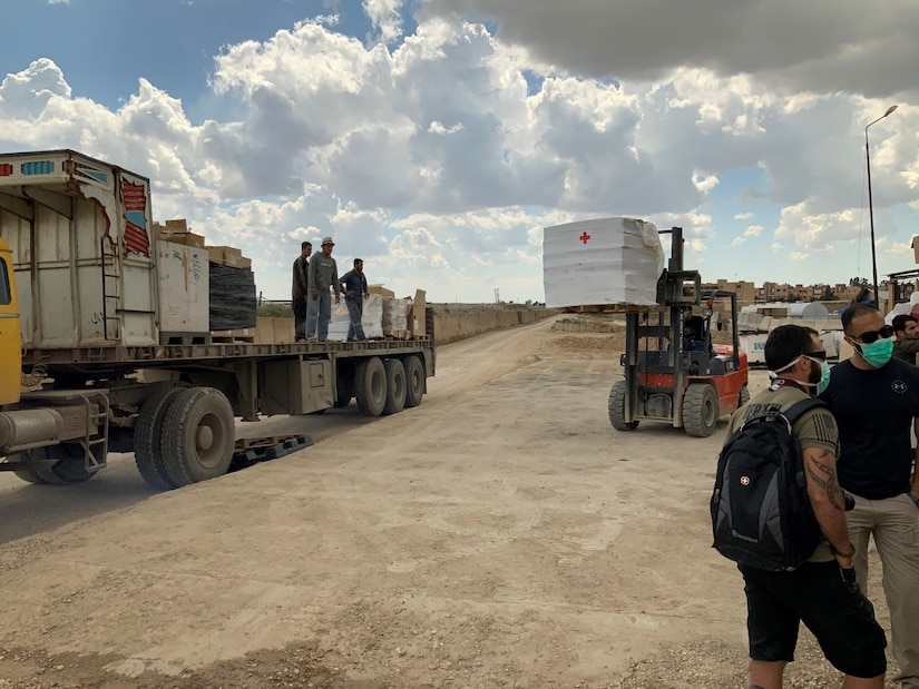 A pallet of basic hygiene and medical supplies is offloaded at Ash Shaddaddi, Syria for detention facilities across northeast Syria the week of April 13, 2020. These supplies are part of a handoff from the Coalition to further support the region's readiness to prevent the spread of COVID-19.