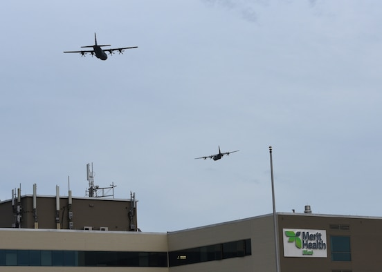 The 403rd Wing's 815th Airlift Squadron conducted a flyover of local hospitals in Gulfport, Biloxi and Ocean Springs along the Mississippi Gulf Coast April 28, 2020. The fly bys were in tribute to all healthcare workers, first responders, and essential personnel battling the spread of COVID-19. (U.S. Air Force photo by Jessica L. Kendziorek)