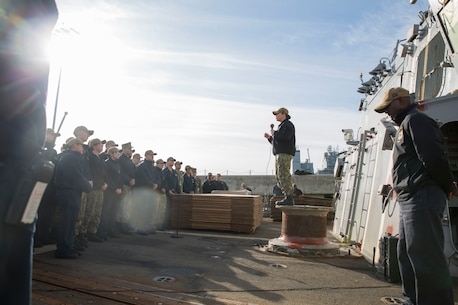 U.S. Navy Cmdr. Mary Devine, Commanding Officer of the USS Bainbridge (DDG-96) speaks to Sailors prior to a U.S. Marine Corps and U.S. Navy leadership tour aboard USS Bainbridge at Naval Station Norfolk, Norfolk, Virginia, Jan. 31, 2020. The tour was held to familiarize U.S. Marine Corps leaders with the capabilities of the vessel, increasing naval integration. The USS Bainbridge is an Arleigh Burke-class guided missile destroyer. (U.S. Marine Corps Photo by Cpl. Desmond Martin/released)