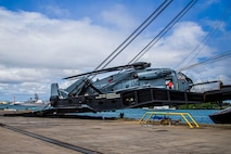 U.S. Marines with Marine Heavy Helicopter Squadron 463, Marine Aircraft Group 24, haul a CH-53E Super Stallion off the ramp of a vehicle carrier vessel on Joint Base Pearl Harbor-Hickam, April 24, 2020. HMH-463 offloaded a CH-53E following a maintenance operation overseas. (U.S. Marine Corps photo by Lance Cpl. Jacob Wilson)