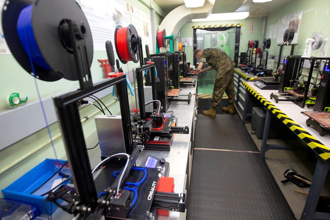 3D printer printing mask frames.