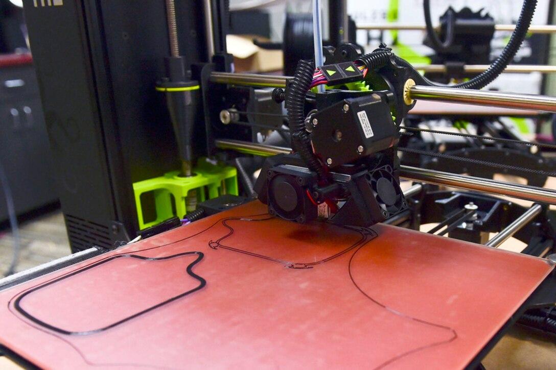 3D printer prints face masks.