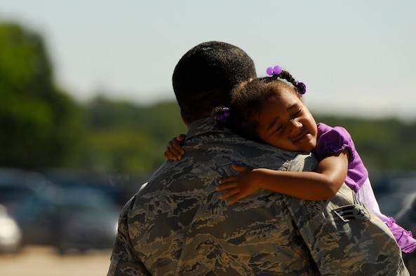 Kaliyah, three, hugs her father U.S. Air Force Senior Airman Damien Williams.