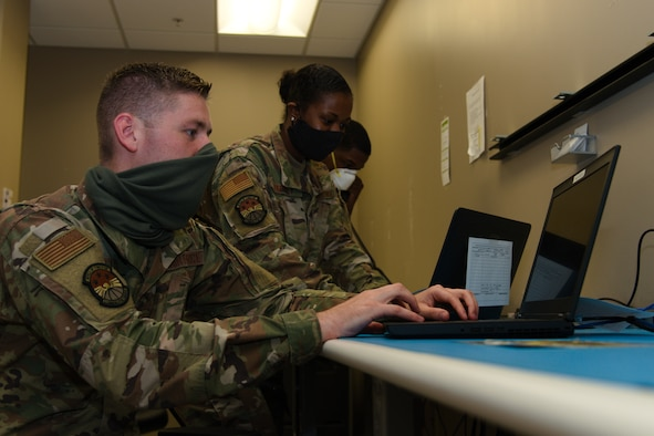 Airmen from the 6th Communications Squadron (CS) troubleshoot customer maintenance requests at MacDill Air Force Base, Fla., Apr. 23, 2020.