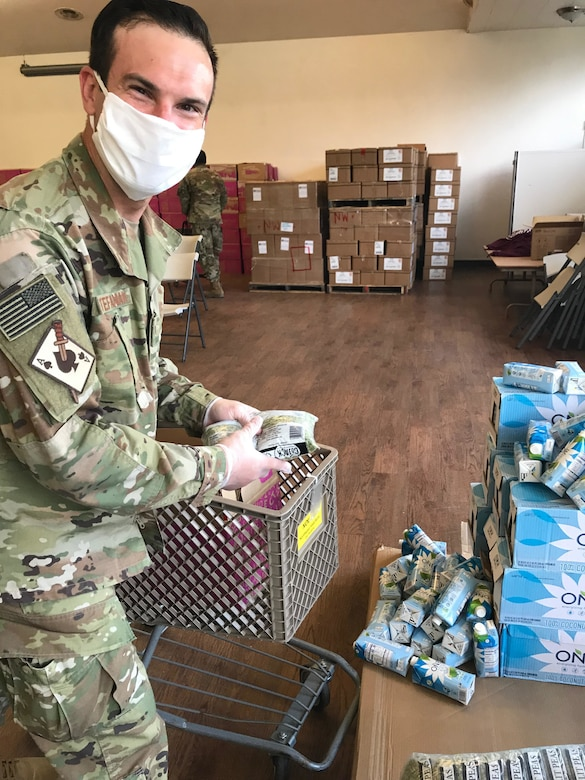 U.S. Air Force Staff Sgt. David Stefaniak, a boom operator with the Washington Air National Guard's 116th Air Refueling Squadron, sorts food at the Issaquah Food Bank April 15, 2020. Stefaniak is supporting multiple food banks in the Puget Sound area as part of the state's COVID-19 response.