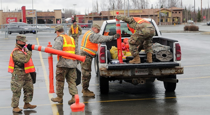 Alaska National Guard Soldiers and Airmen, Alaska State Defense Force Soldiers and Naval Militiamen assigned to a joint task force supported the Food Bank of Alaska by establishing an efficient food distribution area in Muldoon April 20, 2020.