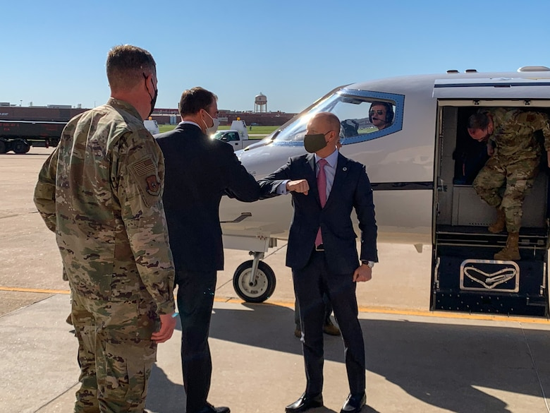 While performing the duties of Under Secretary of the Air Force Shon Manasco is greeted by Oklahoma Gov. Kevin Stitt after arriving at Tinker Air Force Base, Oklahoma, April 29, 2020.  Manasco visited Tinker in order to learn more about how the base has adapted to the COVID-19 crisis. (U.S. Air Force photo by Jonathan Stock)
