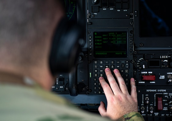 Photo of an Airman conducting a pre-flight check in an HC-130J Combat King II.