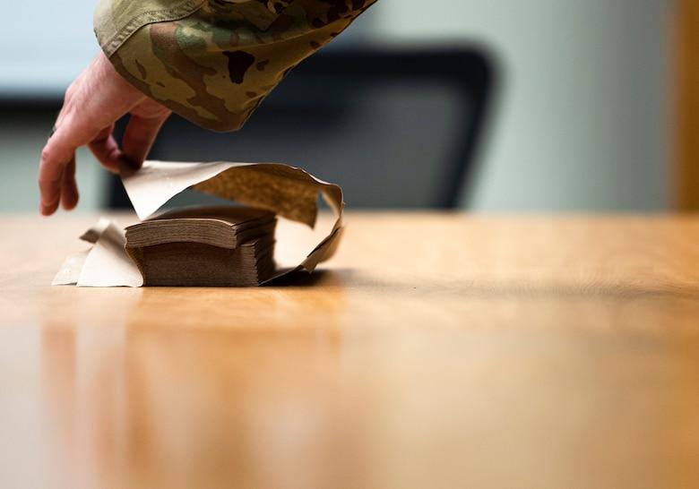 Photo of an Airman grabbing a paper towel.