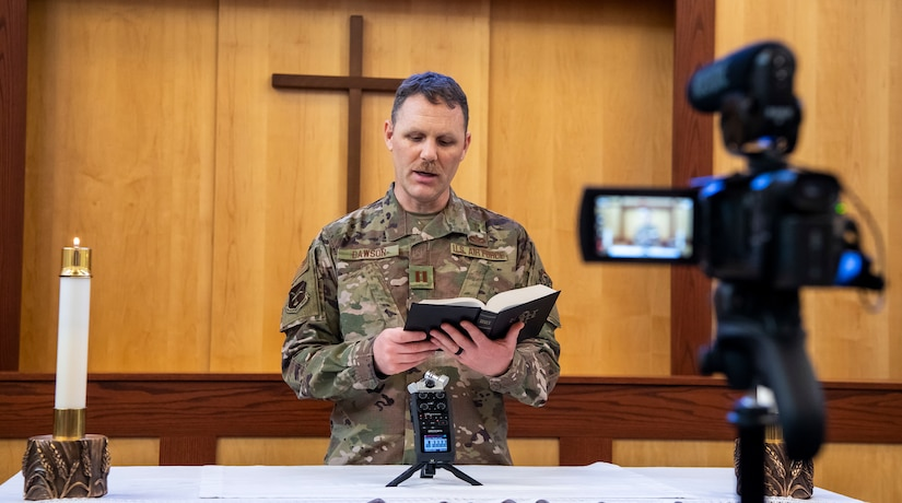 A chaplain speaking in front of a video camera.