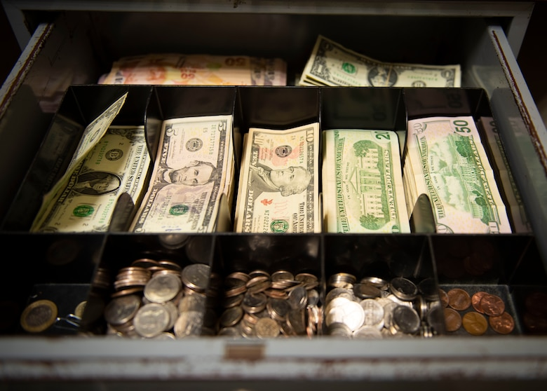 Photo of money in a cash box
