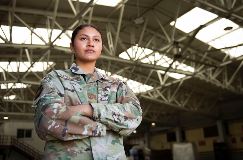 Photo of an Airman with her arms crossed