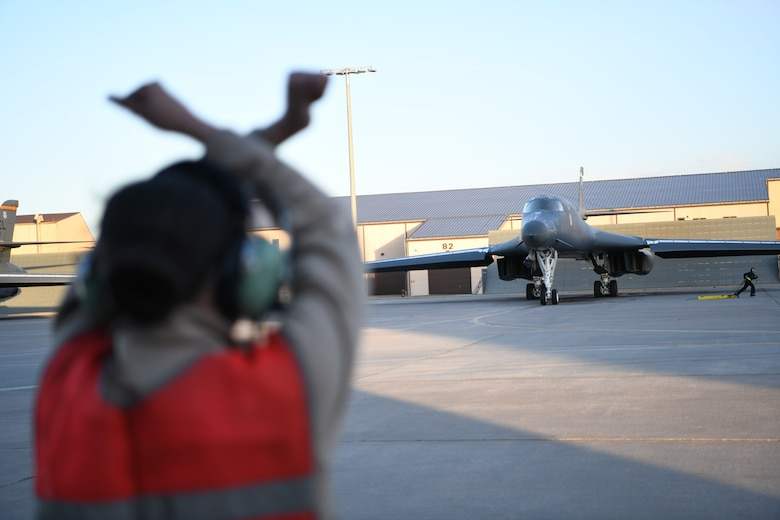 A B-1B Lancer assigned to the 28th Bomb Wing is guided out to the runway to launch from Ellsworth Air Force Base, S.D., April 28, 2020. A pair of B-1s flew from the continental United States and conducted operations over the South China Sea as part of a joint U.S. Indo-Pacific Command and U.S. Strategic Command Bomber Task Force mission. (U.S. Air Force photo by Senior Airman Nicolas Erwin)