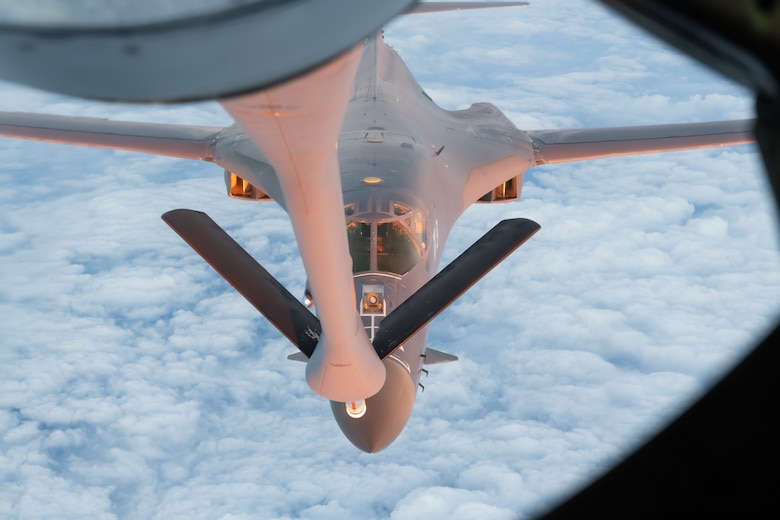 A U.S. Air Force B-1B Lancer from the 28th Bomb Wing, Ellsworth Air Force Base, S.D., refuels with a KC-135 Stratotanker from the 909th Air Refueling Squadron during a 32-hour round-trip sortie to conduct operations over thePacific as part of a joint U.S. Indo-Pacific Command and U.S. Strategic Command (USSTRATCOM) Bomber Task Force (BTF) mission April 30, 2020. This operation demonstrates the U.S. Air Force's dynamic force employment model in line with the National Defense Strategy's objectives of strategic predictability with persistent bomber presence, assuring allies and partners. (U.S. Air Force photo by Senior Airman Cynthia Belío)