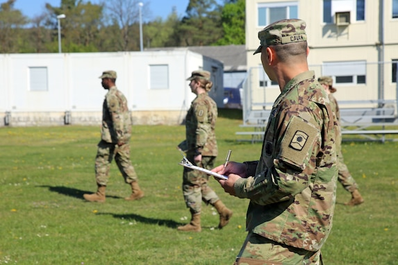 U.S. Army Reserve Sgt. 1st Class Roi Cavan, human resources noncommissioned officer-in-charge with the 361st Civil Affairs Brigade, 7th Mission Support Command, evaluates a student marching Soldiers during a virtual Basic Leader Course in Kaiserslautern, Germany, April 21, 2020. Two 7th MSC NCOs are providing leadership as assistant instructors for one of 20 classes in four countries across Europe during the first-ever four-week virtual BLC course being led by the 7th Army NCO Academy out of Grafenwoehr, Germany.