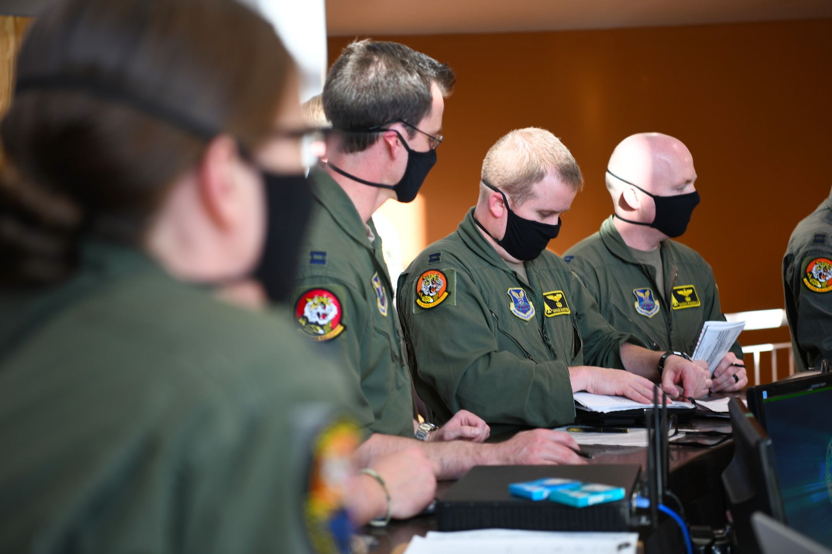 Aviators from the 37th Bomb Squadron receive a final mission briefing before launching B-1B Lancers from Ellsworth Air Force Base, S.D., April 28, 2020. The crew flew two B-1s from the continental United States and conducted operations over the South China Sea as part of a joint U.S. Indo-Pacific Command and U.S. Strategic Command Bomber Task Force mission. (U.S. Air Force photo by Senior Airman Nicolas Erwin)