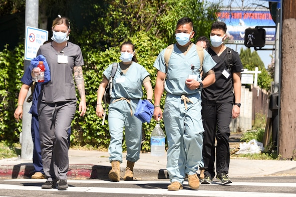 California National Guard medical support team members don PPE and prepare to work at a skilled nursing facility in Southern California to fulfill humanitarian support missions at the direction of the Governor, April 29, 2020. The medical support team is supporting staff at the facility, sharing best practices, and providing patient care for non-COVID-19 positive patients at the facility. (Air National Guard photo by Capt. Jason Sanchez)
