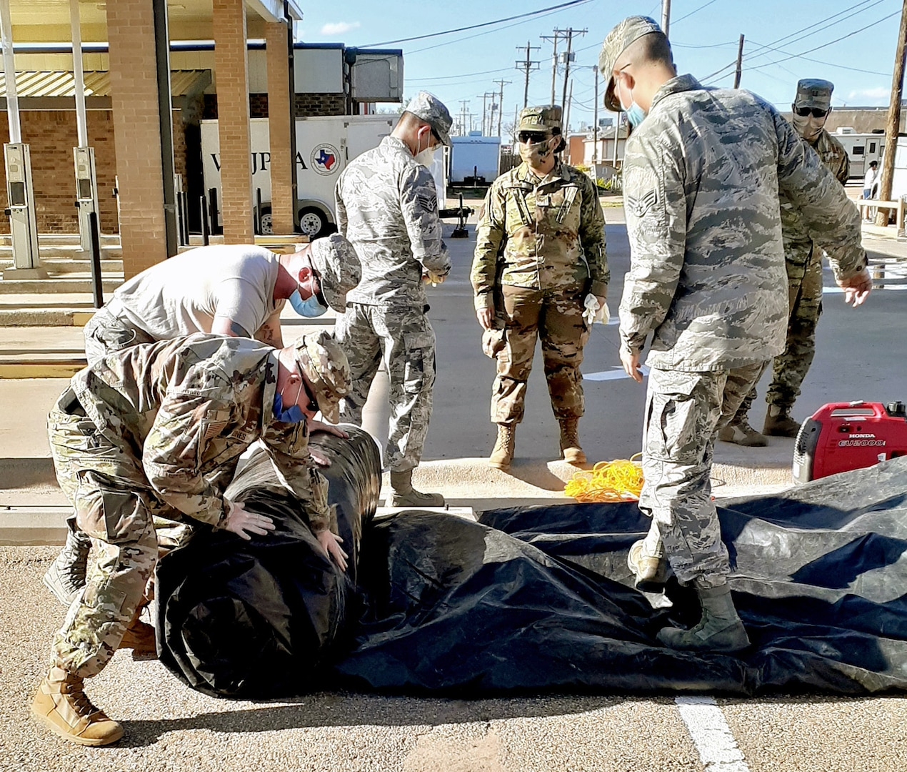 Air National Guard members with the 149th Fighter Wing break down a testing station at a community-based testing facility in Dumas, Texas, April 23