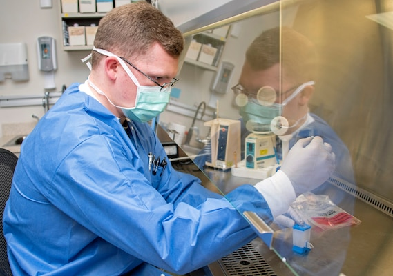 Army Spc. David Pyke, medical laboratory technician, loads a patient sample for rapid COVID-19 polymerase chain reaction, or PCR, testing at Brooke Army Medical Center, Joint Base San Antonio-Fort Sam Houston, April 9. PCR is the central technology for COVID-19 testing.
