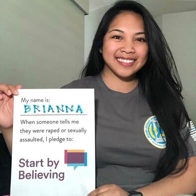 Brianna Sarabia-Templin, volunteer victim advocate, holds a pledge to believe sexual assault survivors.