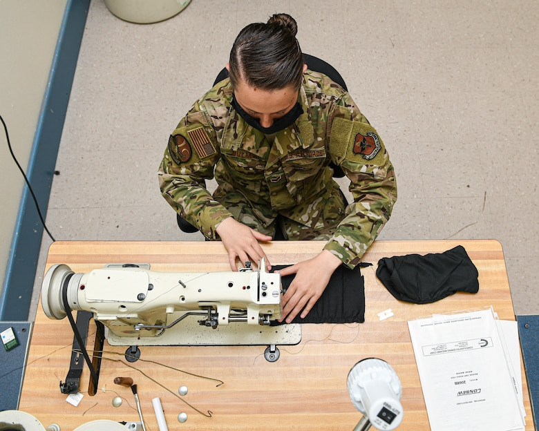 photo of Airman working on a sewing machine