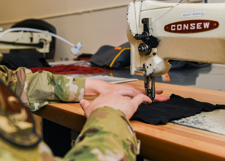 hands of an Airman at a sewing machine