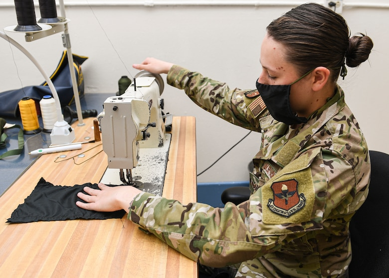 Airman working on a sewing machine