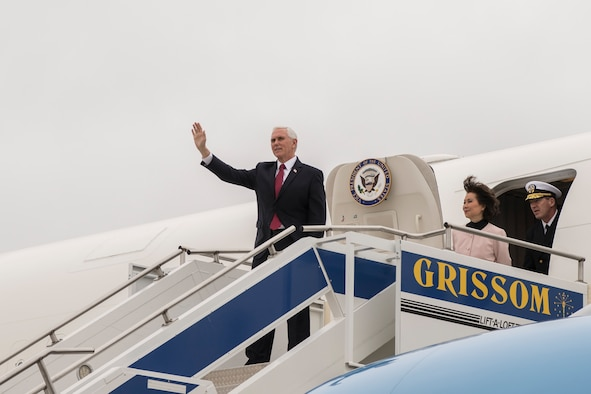 Vice President Mike Pence waves to news media after arriving at Grissom Air Reserve Base, Indiana April 30, 2020.Pence came to Indiana to meet with local business leaders who are building ventilators during the COVID-19 outbreak. (U.S Air Force photo/Ben Mota)
