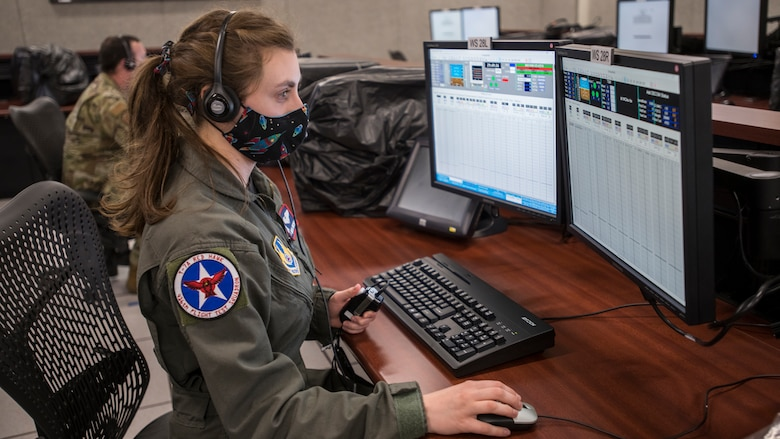 Rebecca Mitchell, T-7A Lead Flight Test Engineer, 416th Flight Test Squadron, watches real-time flight telemetry of a remote T-7A Red Hawk test flight from the Boeing flight test center in St. Louis, Missouri, at the Ridley Mission Control Center on Edwards Air Force Base, California, April 30. (Air Force photo by Giancarlo Casem)