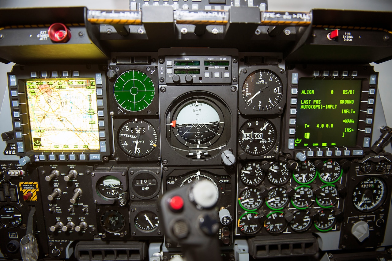 A full mission trainer cockpit is on display.