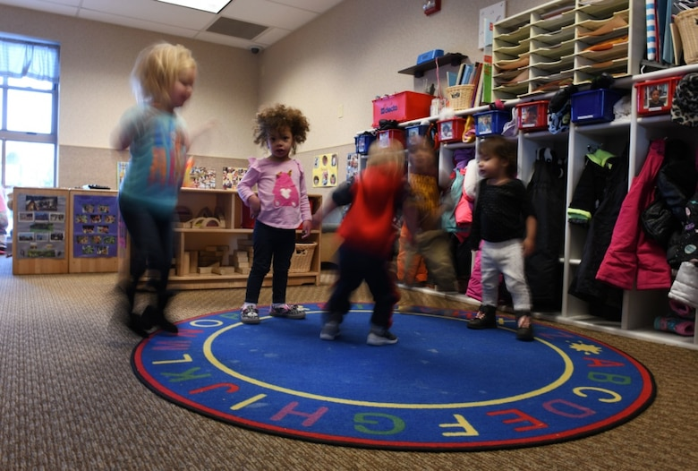 "Toddlers from room 138 dance to ""Jingle Bells"" at the McRaven Child Development Center on Ellsworth Air Force Base, S.D., Dec. 6, 2018. April has been designated as the Month of the Military Child. It is set aside to honor the strength and sacrifices of military children across all branches. (U.S. Air Force photo by Airman 1st Class Christina Bennett)"