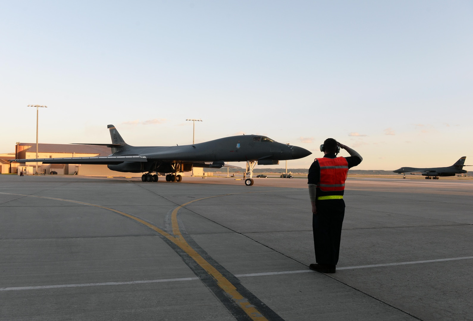 A maintainer salutes a B-1B Lancer assigned to the 28th Bomb Wing as it taxis to the runway to launch from Ellsworth Air Force Base, S.D., April 28, 2020. A pair of B-1s flew from the continental United States and conducted operations over the South China Sea as part of a joint U.S. Indo-Pacific Command and U.S. Strategic Command Bomber Task Force mission. (U.S. Air Force photo by Airman Quentin Marx)