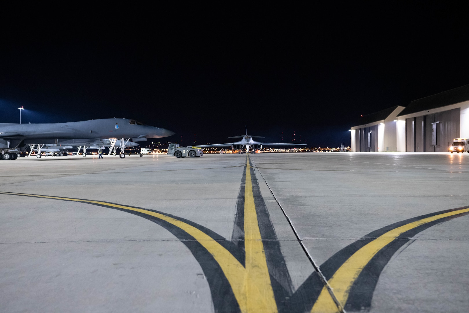 Two B-1B Lancers taxi to their spots on the flight line after landing at Ellsworth Air Force Base, S.D., April 30, 2020. The B-1s, assigned to the 28th Bomb Wing, flew a 32-hour round-trip sortie to conduct operations over the South China Sea as part of a joint U.S. Indo-Pacific Command and U.S. Strategic Command Bomber Task Force mission. (U.S. Air Force photo by Tech. Sgt. Jette Carr)