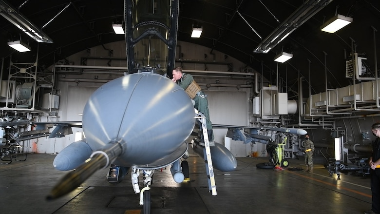 Col Kristopher Struve, 35th Fighter Wing commander, Misawa Air Base, Japan, prepares to execute an air-to-air sortie with Lt Gen Kevin B. Schneider, 5th Air Force commander, April 29, 2020. This training continues amid COVID-19 concerns and mitigation efforts.