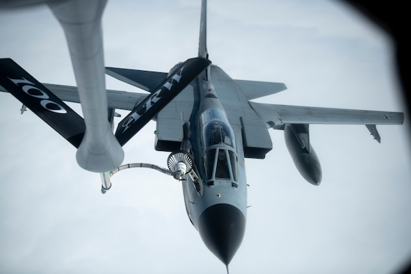Fighter aircraft being refueled in mid-air.
