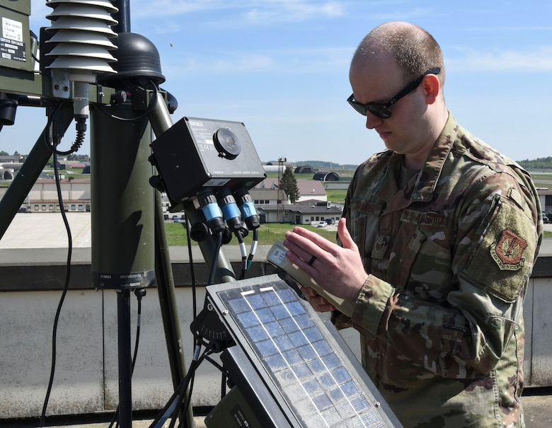 U.S. Air Force Staff Sgt. Bradley Gallaher, 52nd OSS Weather Flight training manager, uses a Tactical Meteorological Observation System (TMQ-53), at Spangdahlem Air Base, Germany, April 28, 2020. Gallaher has been maintaining mission readiness during the COVID-19 pandemic by ensuring records and training are up to date. (U.S. Air Force photo by Senior Airman Melody W. Howley)