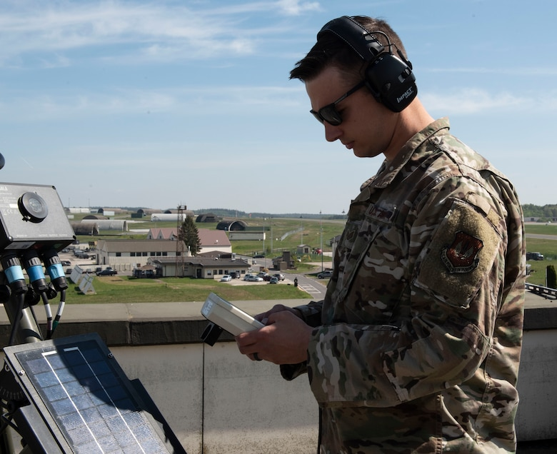 U.S. Air Force Staff Sgt. Kevin Perritt, 52nd OSS Weather Flight NCOIC of mission weather operations, uses a Tactical Meteorological Observation System (TMQ-53), at Spangdahlem Air Base, Germany, April 28, 2020. Perritt has been maintaining mission readiness during the COVID-19 pandemic by creating new products for the 480th Fighter Squadron in helping make their mission planning more seamless when prepping for weather limiting factors. (U.S. Air Force photo by Senior Airman Melody W. Howley)