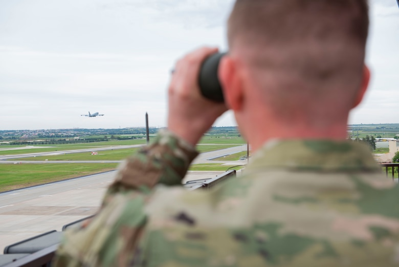 U.S. Air Force Tech. Sgt. Damian Mize, 39th Operation Support Squadron air traffic control watch supervisor, watches an aircraft take off at Incirlik Air Base, Turkey, April 24, 2020.