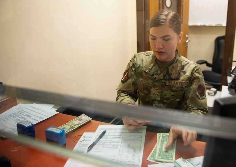 U.S. Air Force Airman 1st Class Caroline Mixon, 39th Comptroller Squadron financial technician, counts money behind the cash cage at Incirlik Air Base, Turkey, April 22, 2020.