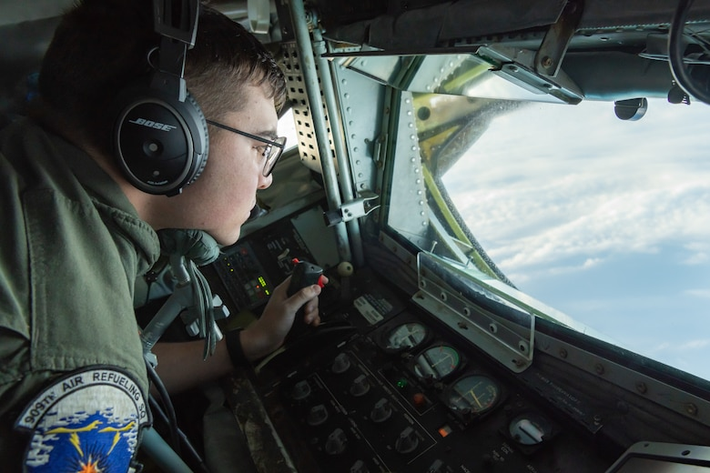 U.S. Air Force Airman 1st Class Dillon Neal, boom operator assigned to the 909th Air Refueling Squadron, prepares to refuel a B-1B Lancer from the 28th Bomb Wing, Ellsworth Air Force Base, S.D., during a 32-hour round-trip sortie to conduct operations over the Pacific as part of a joint U.S. Indo-Pacific Command and U.S. Strategic Command (USSTRATCOM) Bomber Task Force (BTF) mission April 30, 2020. The 909th ARS enables the execution of tactical, conventional, and peacetime operations in the Indo-Asia Pacific region. (U.S. Air Force photo by Senior Airman Cynthia Belío)