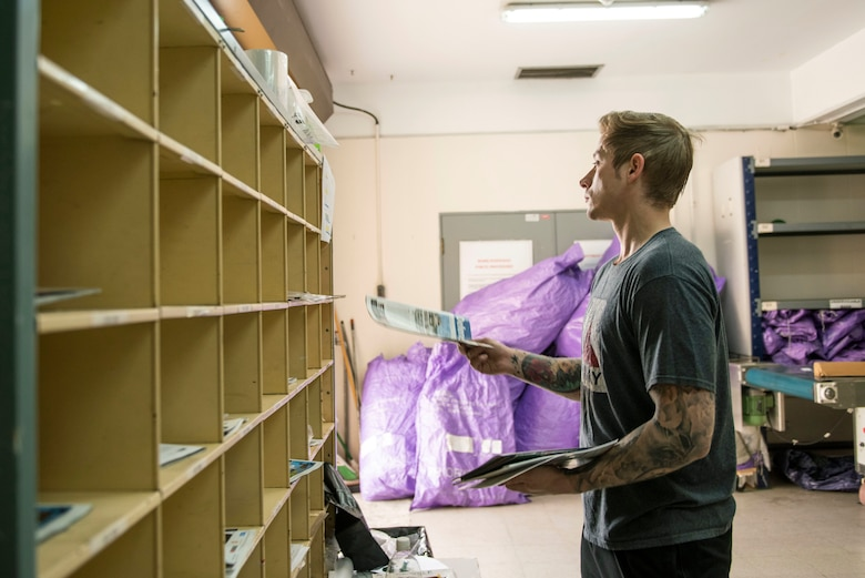 U.S. Air Force Staff Sgt. Garrett Bowman, 39th Force Support Squadron non-commissioned officer in charge of official mail, sorts mail at the post office April 24, 2020, at Incirlik Air Base, Turkey. The Postal Service plays a key role in the morale of U.S. troops stationed overseas, since it is a popular avenue for troops to connect back to home. (U.S. Air Force photo by Staff Sgt. Joshua Magbanua)