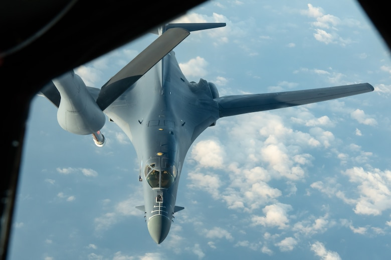 A U.S. Air Force B-1B Lancer from the 28th Bomb Wing, Ellsworth Air Force Base, S.D., approaches a KC-135 Stratotanker from the 909th Air Refueling Squadron, to refuel during a 32-hour round-trip sortie to conduct operations over the Pacific as part of a joint U.S. Indo-Pacific Command and U.S. Strategic Command (USSTRATCOM) Bomber Task Force (BTF) mission April 30, 2020. This operation demonstrates the U.S. Air Force's dynamic force employment model in line with the National Defense Strategy's objectives of strategic predictability with persistent bomber presence, assuring allies and partners. (U.S. Air Force photo by Senior Airman Cynthia Belío)
