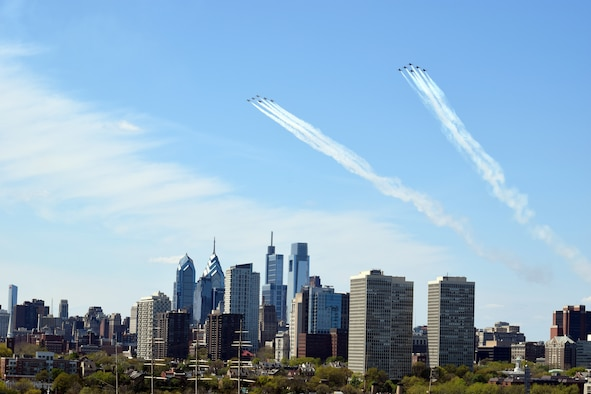 The U.S. Air Force Thunderbirds and the U.S. Navy Blue Angels fly over Philadelphia during an America Strong flyover, April 28, 2020. The demonstration teams conducted flyovers in areas of New York, New Jersey and Pennsylvania to honor healthcare workers, first responders, and other essential personnel who are working on the front lines to combat COVID-19. (U.S. Air Force photo by Maj. Brian Wagner)