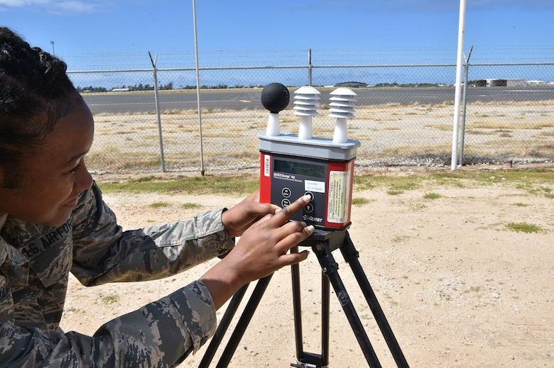 Senior Airman Erica Daniels, 15th Medical Group Bioenvironmental Engineering Flight bioenvironmental engineering technician, checks the Wet-bulb Globe Temperature readings to determine environmental hazards for Airmen at Joint Base Pearl Harbor-Hickam, Hawaii, July 16, 2020. The three sensors on top, from left to right, measure the Globe Bulb temperature, the Natural Wet Bulb temperature, and the Dry Bulb temperature. (U.S. Air Force Photo by 2nd Lt. Benjamin Aronson)
