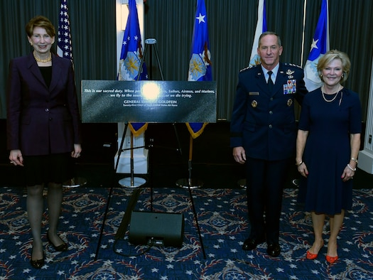 """Secretary of the Air Force Barbara M. Barrett, left, Air Force Chief of Staff David L. Goldfein and Mrs. Dawn Goldfein pose with a representation of an etching that is now displayed on the Wall of Valor at the Air Force Memorial during a ceremony at Joint Base Anacostia-Bolling, Washington, D.C., July 31, 2020. The ceremony unveiled a new etching for the memorial's Wall of Valor at the Air Force Memorial that reads, """"This is our sacred duty. When protecting Soldiers, Sailors, Airmen and Marines, we fly to the sound of the guns … or we die trying."""" (U.S. Air Force photo by Wayne Clark)"""